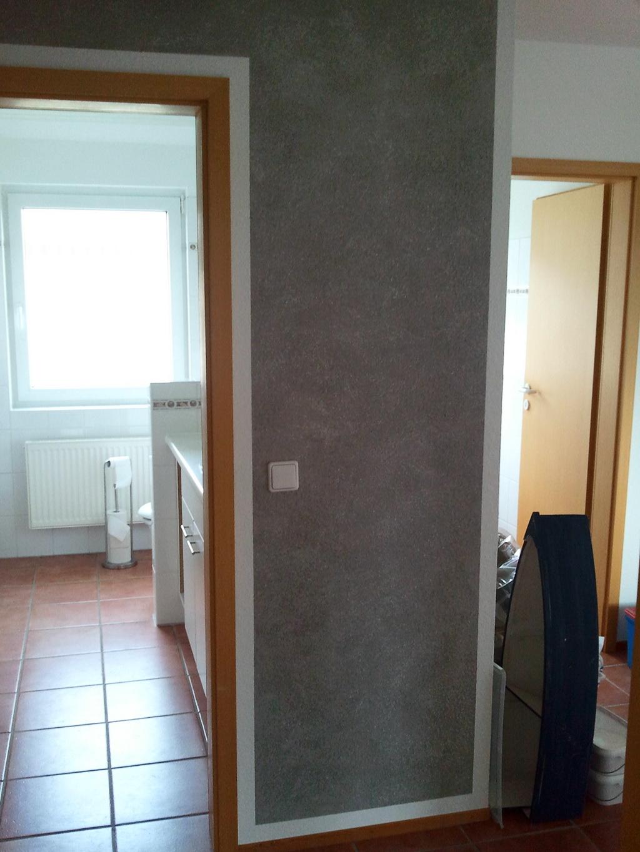 Wand Wischtechnik in Grau mit weißen Effekt Pigmenten